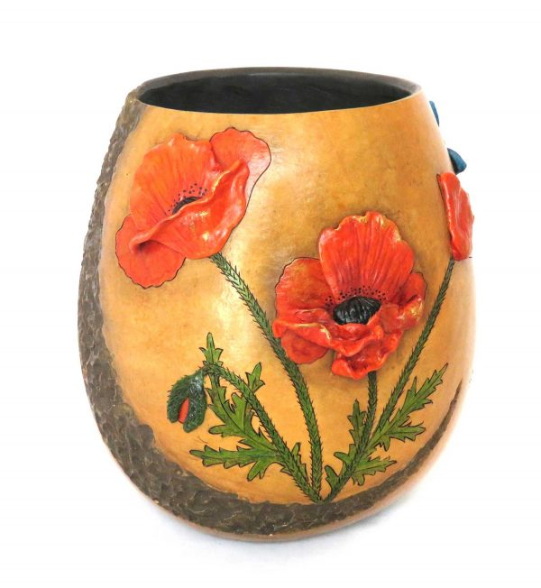 A decorative gourd container with poppies