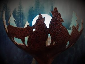 A decorative gourd lamp with wolves and trees