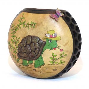 A decorative gourd container with a tortoise and a butterfly