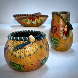 3 decorative gourds with different paint schemes
